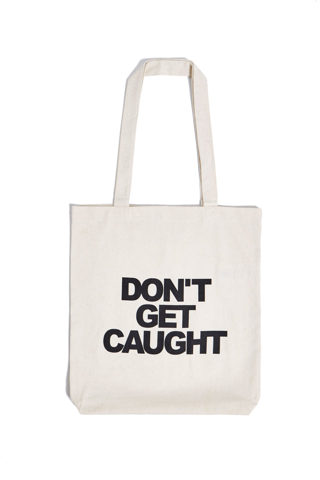 Don't Get Caught Tote Bag