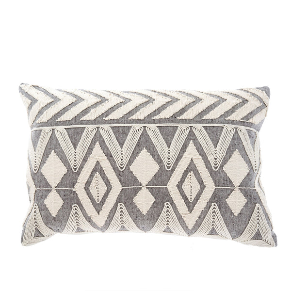 A grey, rectangular shaped pillow with a white diamond shaped pattern embroidered onto the front. Home decor. Handpicked homewares by Farmers Daughter Interiors + design. Shop local Swift Current Saskatchewan. Shop saskatoon. Shop Regina SK. YXE, YQR. Throw pillows. Prairie modern decor. Modern bohemian decor. Home design. Interior design. Pillows. Tribal print. Aztec patterned. Trendy home decor. Shop small.