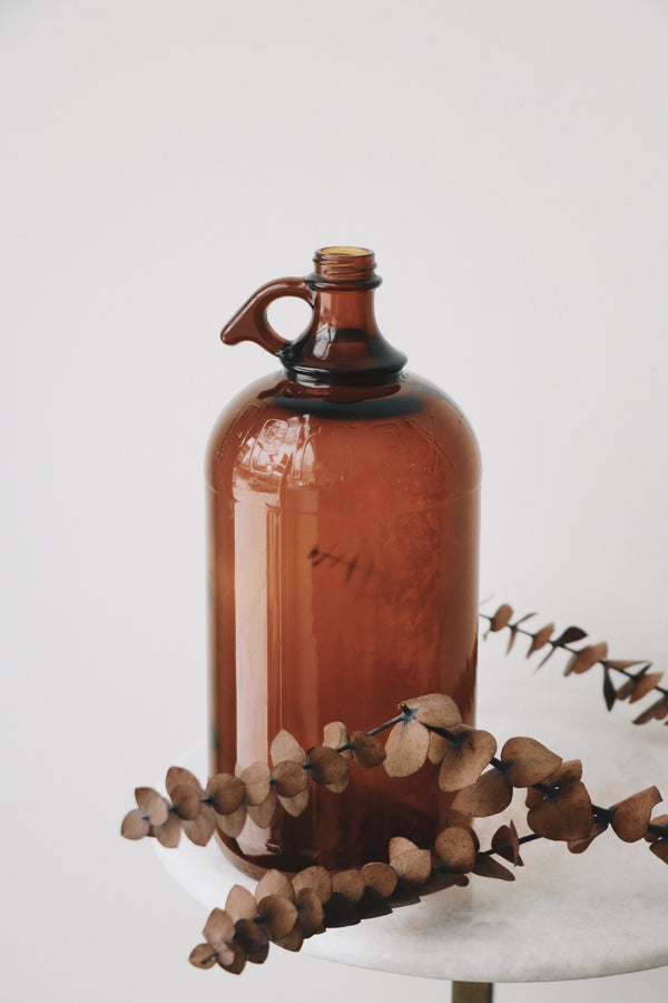 FOUND. Amber Half Gallon Jug