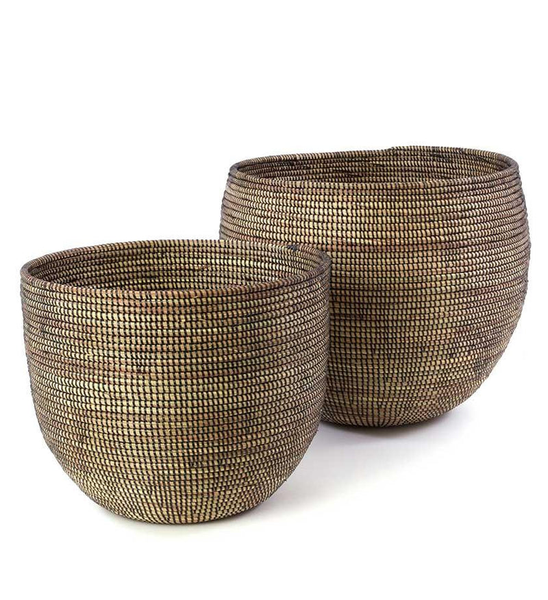 A round tan basket woven from cattail stalks and recycled black plastic. For storage of throws, blankets, shoes, towels or use as decor. Handmade baskets. Fair trade baskets. Modern Prairie living. Home decor. Handpicked homewares. Shop online. Local Swift Current SK Shop.