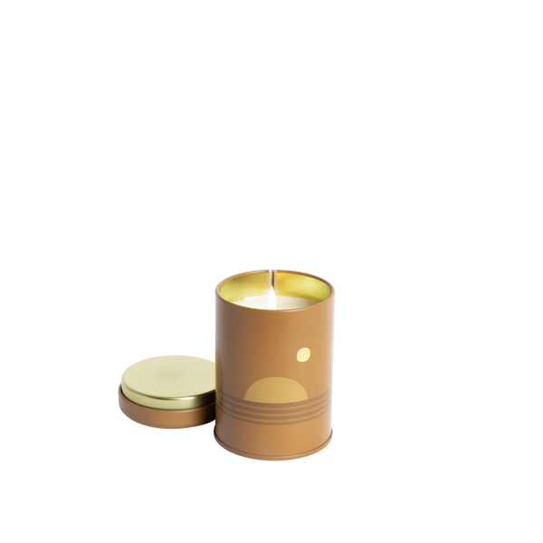 P.F Candle Co Sunset Collection in Dusk. Candle comes in a brown coloured tin with a 70s inspired sunset motif.  The scent notes are clary sage, iris, and palo santo. Shop Local Swift Current SK. Shop local Saskatchewan. Saskatoon. Regina. YXE. YQR. Shop online. Handpicked homewares. Handmade candles.
