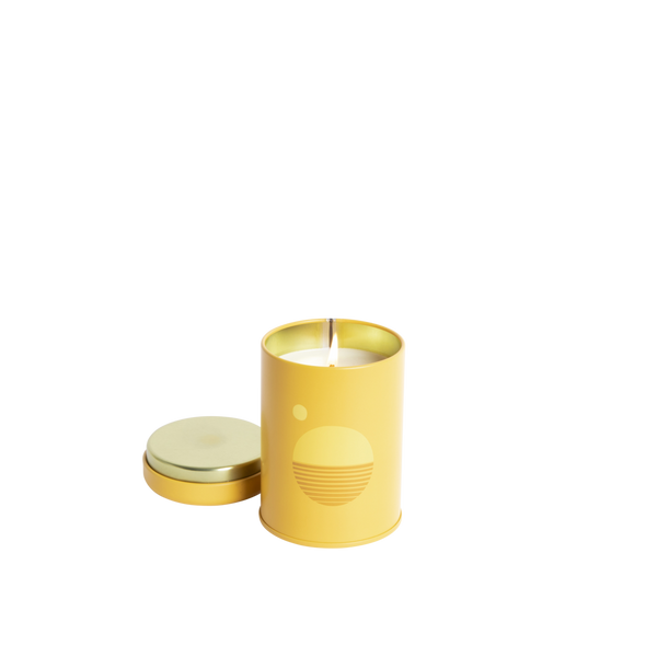 P.F Candle Co Sunset Collection in Golden Hour. Candle comes in a yellow coloured tin with a 70s inspired sun motif.  The scent notes are bergamot, hay, and golden poppy. Shop Local Swift Current SK. Shop local Saskatchewan. Saskatoon. Regina. YXE. YQR. Shop online. Handpicked homewares. Handmade candles. Home fragrance. Reed Diffuser. Prairie Modern Decor. Shop bohemian decor. Prairie living. Home Decor.