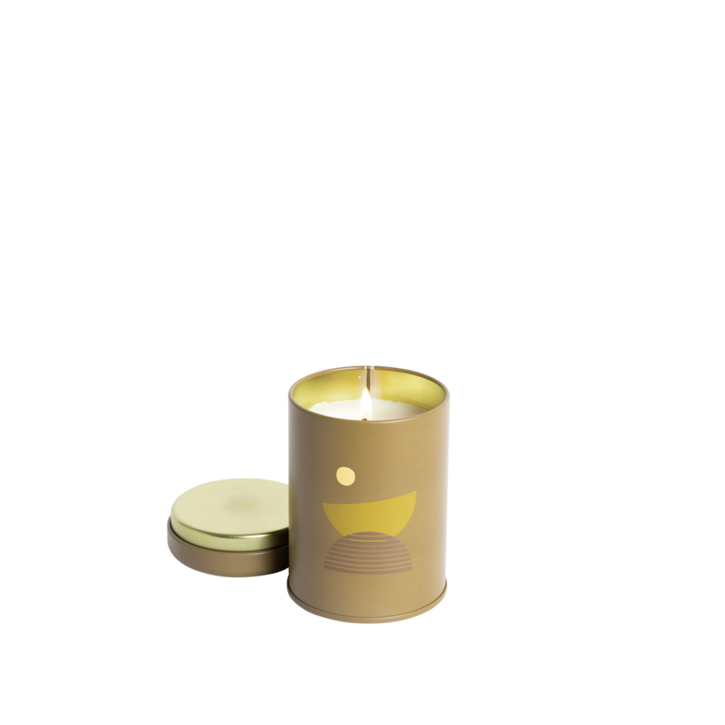 P.F Candle Co Sunset Collection in Moonrise. The candle comes in a green painted tin with a 70s inspired moon motif.  The scent notes are yuzu, indian jasmine, and smoked cedarwood. Shop Local Swift Current SK. Shop local Saskatchewan. Saskatoon. Regina. YXE. YQR. Shop online. Handpicked homewares. Handmade candles. Home fragrance. Reed Diffuser. Prairie Modern Decor. Shop bohemian decor. Prairie living. Home Decor.