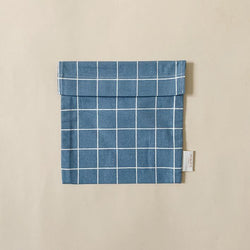 Haps Nordic Reusable sandwich bag in blue colour called ocean with check pattern. Velcro closure. Washable, sustainable snack bag. Canadian retailer. Shop online