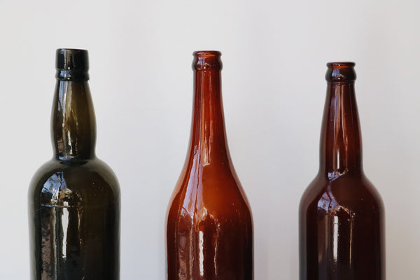 FOUND.  Amber Glass Bottles (Set of 3)