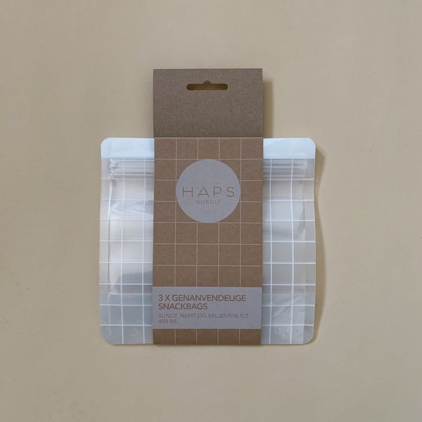 Haps Nordic Reusable Snack Bag in clear with checkered pattern. 400 ml size. Reusable, sustainable, washable ziplock bag. Freezer safe. Shop Online. Canadian Retailer