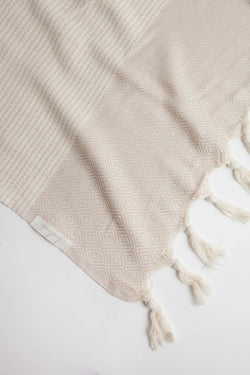Beige coloured Turkish towel with tassel edging. Made of 100% Turkish Cotton. Beach Towel, Bath towel. Shop online. Local Swift Current SK Shop. Home decor. Modern. Bohemian. Prairie Living.
