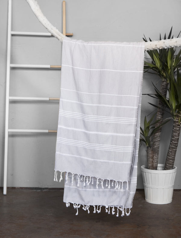 Light Grey with white stripes Turkish Towel with tassel edging. Made from 100% Turkish Cotton. Shop online. Local Swift Current SK Shop. Beach Towel. Bath Towel. Decor