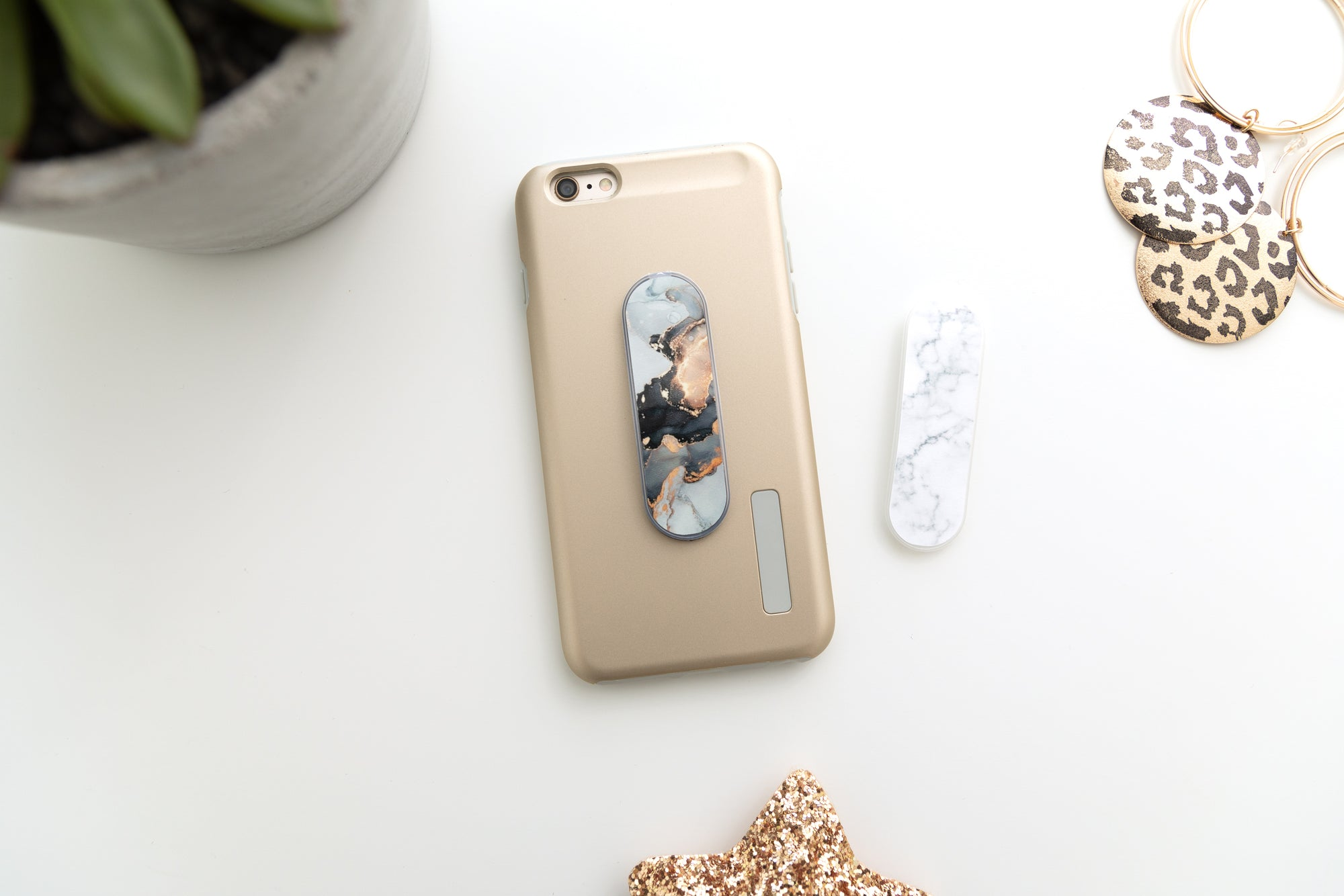 Yubiloop phone accessory, don't drop your phone with this marble design phone loop. Apply to nearly any cell phone or cell phone case. Stylish and fashionable designs are interchangable to match any mood our outfit. Each purchase also donates to charity.