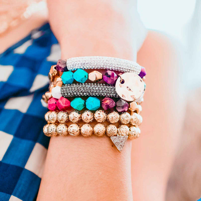 Bracelet stack model photo with gemstone, gold plated, pave CZ, and druzy details.