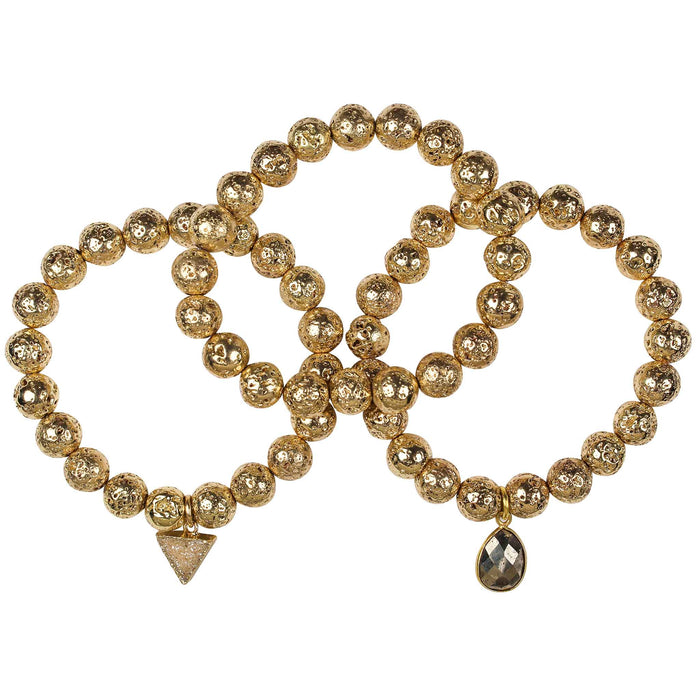 Gold plated lava rock beaded stretch three bracelet set with champagne triangle druzy triangle and pyrite gemstone drop