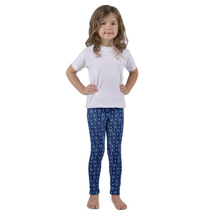 Kid's leggings- Blue Devil head print.  Columbia blue and white devil head. White and columbia blue square pattern , navy background.