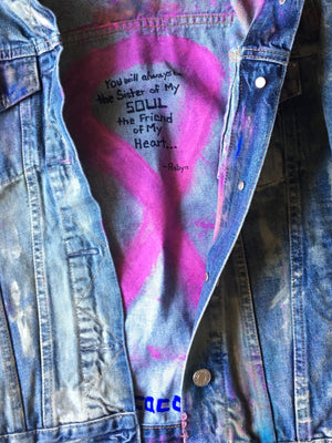 breast cancer ribbon on a customized, denim, hand-painted jean jacket