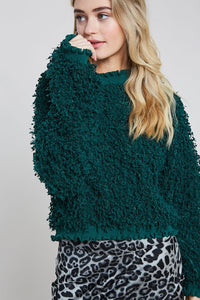TEXTURED MOCK NECK PULLOVER WITH RUFFLE HEM