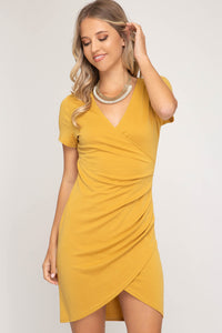 SHORT SLEEVE SURPLICE KNIT DRESS WITH FRONT TUCK DETAIL