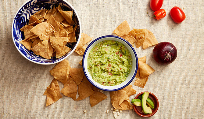 coolfoodstuff.com | 2 bowls showing tortilla chips and guacamole