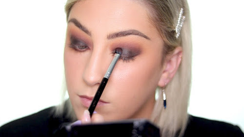 Use a black eyeshadow to set the black cream eyeshadow shade.