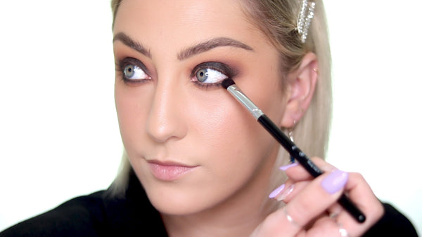 Use the same black eyeshadow and sweep it under your lower lash line.