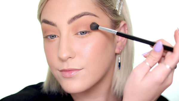 Grab a tan eyeshadow color and sweep it into the contour of your eye.