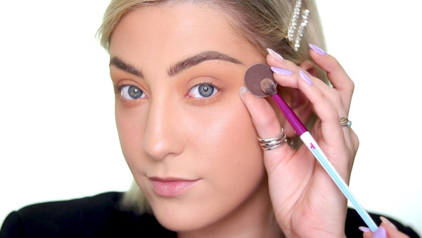 Next, sweep a brown eyeshadow color into the crease of your eye.