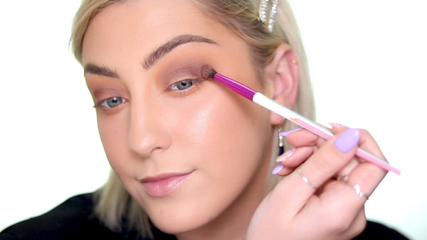 Grab a brown eyeshadow color and sweep it into the contour of the eyelid.