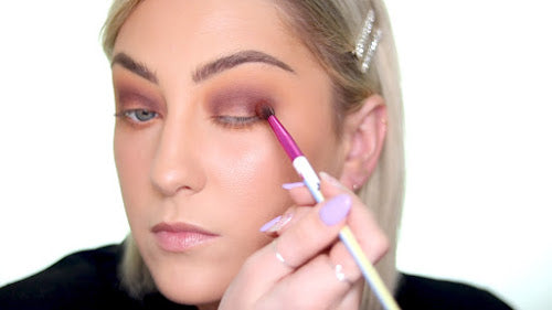 Use a brick red eyeshadow color and sweep it into the outer corner and outer contour of the eye.
