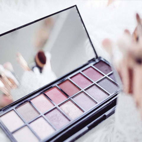 Fall eyeshadow palette with purples and pinks to make your eyes pop for autumn weather.