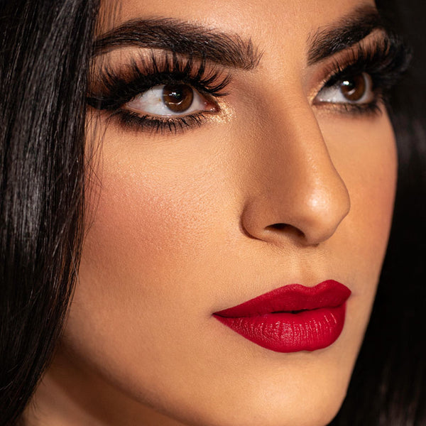 Red lipstick is still on trend for fall 2020 with gorgeous magnetic lashes.