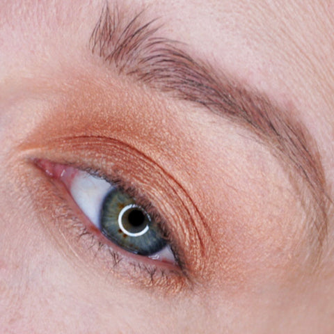 apply a shimmery nude eyeshadow shade on your lower eyelid.