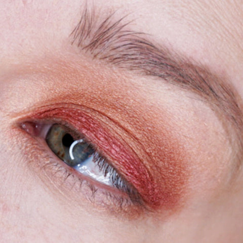 Now take a shimmery cranberry shade and apply it along your upper lash line.