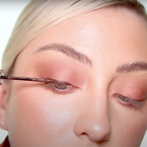 Next apply your brown magnetic eyeliner along your lash line.