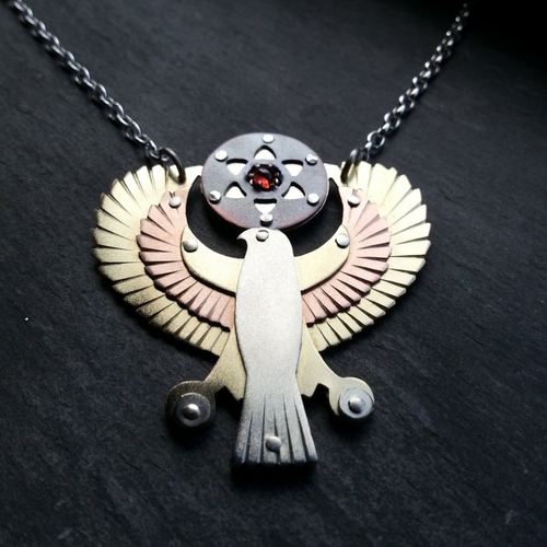 Egyptian Horus Pendant - holding seed of life red garnet