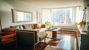 Photo of a condo unit's living room area with a bay window