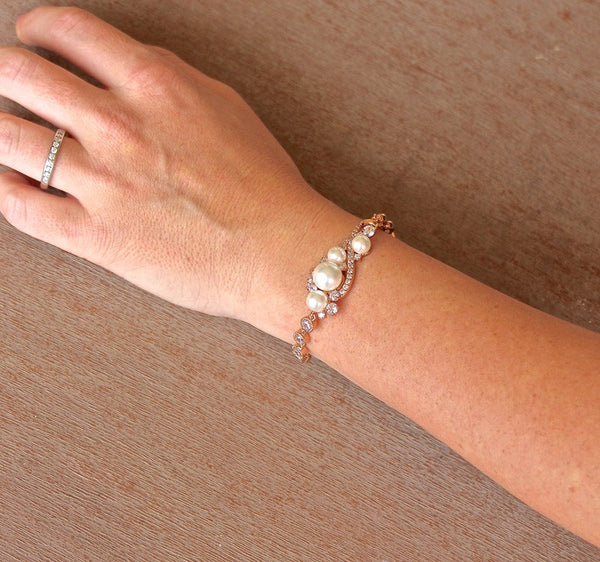 bride wearing rose gold wedding bracelet