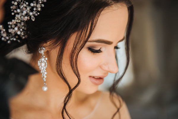 bride wearing long pearl crystal earrings