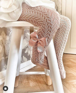 Pink openwork tights with bow