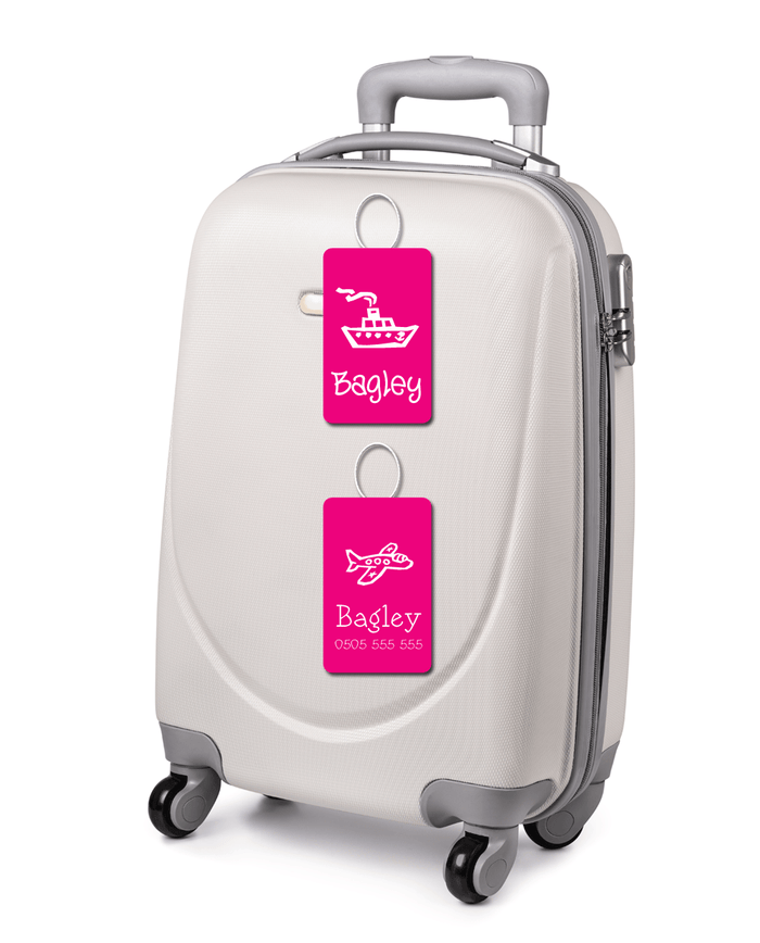 White suitcase with pink luggage tags