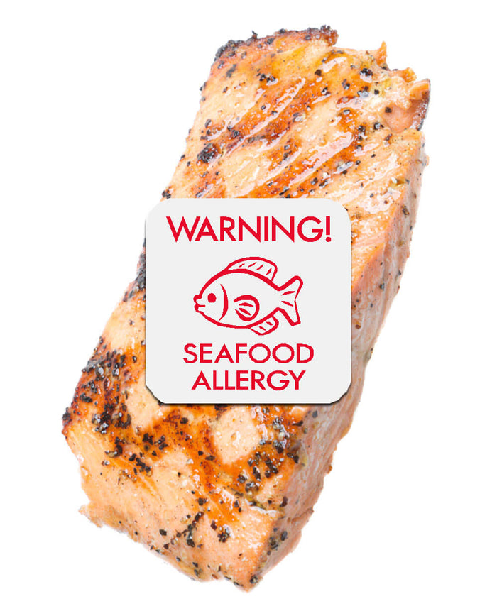 Piece of barbecued salmon with seafood allergy sticker