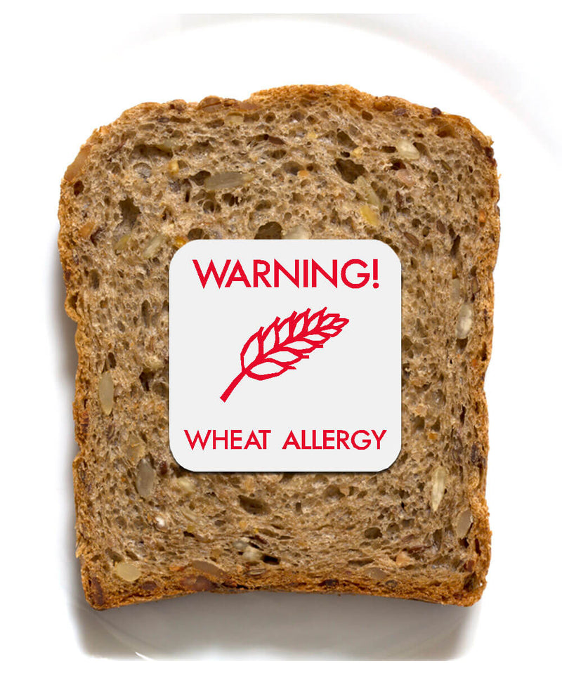 Piece of bread with wheat allergy sticker
