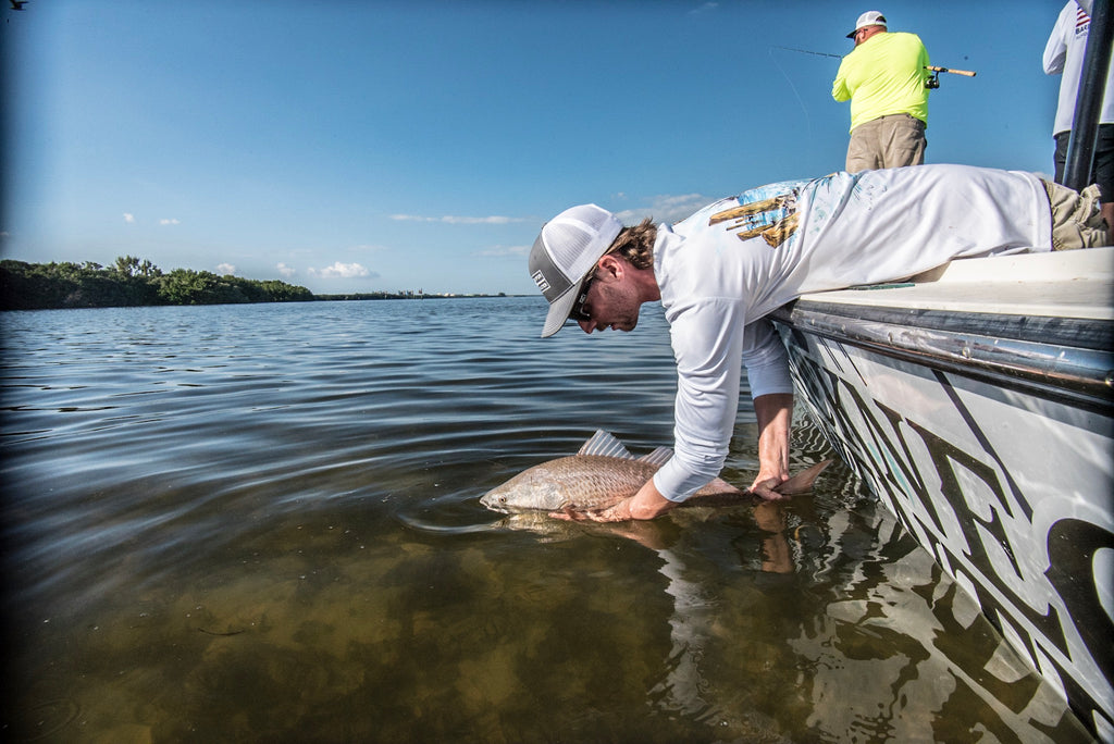 Tim Sommer Releasing a redfish