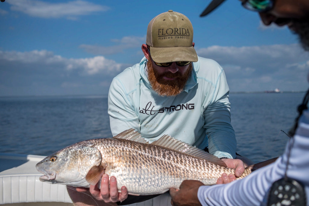 Drew & Captain Mike Goodwine with a Redfish