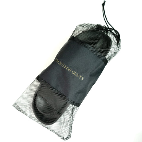 KICKS FOR GENTS TRAVEL MESH TRAVEL BAG WITH KFG MINIMALIST SLIDES in black inside.