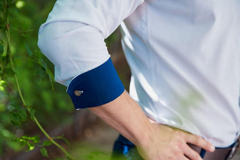Close up on man's right elbow wearing dress shirt but with shirt cuff folded using FLXCUF