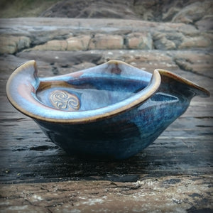 Seamair pottery bowl on rock background