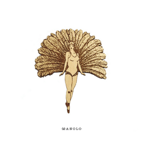 Cabaret dancer woman brooch, in wood painted in gold color. It is from the MANOLO brand, origin of Materia Rica.