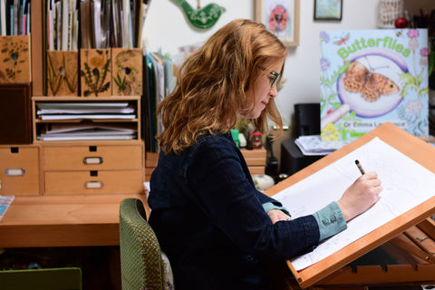 Emma Lawrence drawing in her studio.