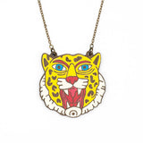 Leopard head necklace with open mouth. Jewel of walnut wood illustrated in yellow color.