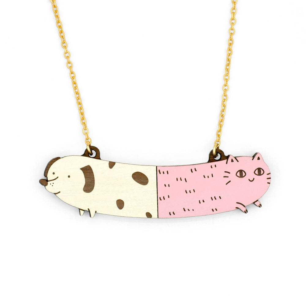 Half cream white dog and pink cat half necklace. With golden chain.