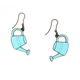 Blue watering can earrings. They are made of wood and are illustrated and the clasp is hook, made of metallic material in old gold, hypoallergenic.