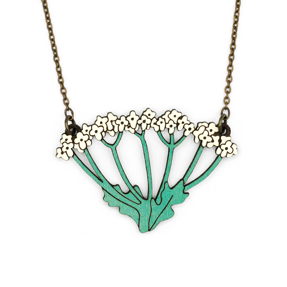 Wild Carrot necklace in the shape of wild carrot flowers, yellow with stalks of green scent. The necklace is made of laser cut wood.